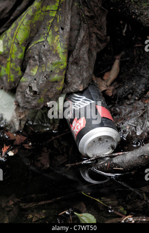 A old can of No Fear thrown away and not cleaned up. - Stock Photo
