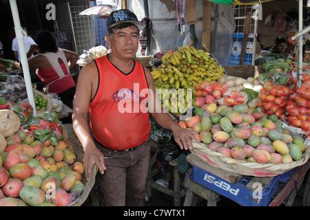 Managua Nicaragua Mercado Oriental flea market marketplace shopping produce stand vegetables fruit vendor merchant - Stock Photo