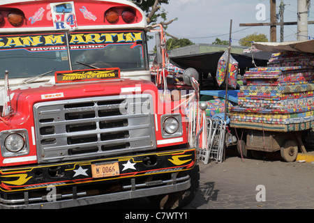 Managua Nicaragua Mercado Oriental flea market marketplace shopping stall public bus painted vehicle red painted - Stock Photo