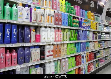 Managua Nicaragua Plaza Espana La Colonia Supermarket grocery store shopping shelves shelf competing products for - Stock Photo