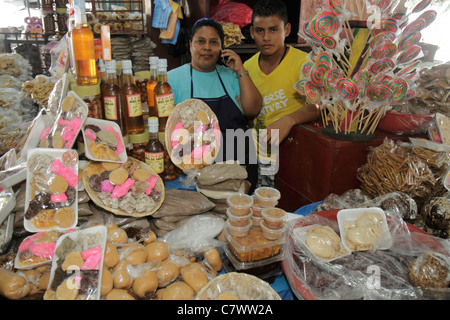 Managua Nicaragua Mercado Roberto Huembes market shopping marketplace baked goods family business owner vendor stall - Stock Photo