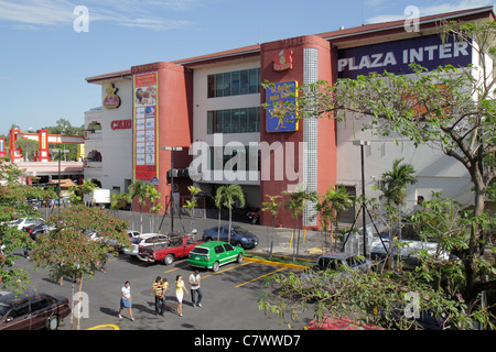 Managua Nicaragua Plaza Inter shopping center mall building signage exterior parking lot car woman man boy child - Stock Photo