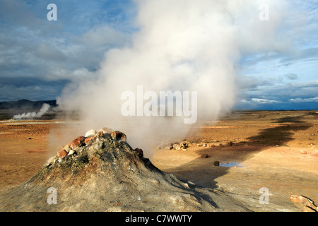 Steaming fumaroles (volcanic vents) at Hverir aka Hverarond east of Myvatn in northeast Iceland. - Stock Photo