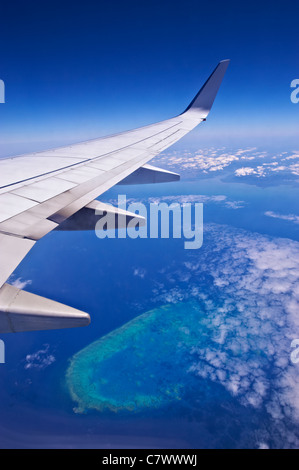 View from airline flying over the Great Barrier Reef Australia - Stock Photo