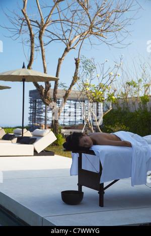 Woman enjoying massage at Alila Villas boutique hotel, Ulu Watu, Bali, Indonesia - Stock Photo