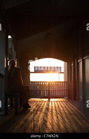 Girl waiting at Bulimba Ferry Terminal, Brisbane Australia - Stock Photo