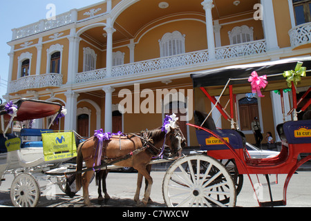 Nicaragua Granada Granada Square Calle Vega colonial heritage historic district architecture balcony bright colors - Stock Photo