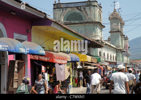 Nicaragua Granada Calle Atravesada colonial heritage neighborhood street scene building business shopping market - Stock Photo
