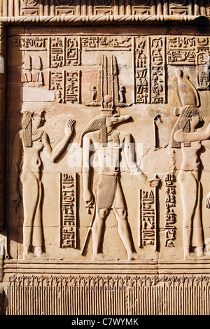 A wall carving depicting the crocodile headed god Sobek at the ancient ruins of Kom Ombo on the Nile River in southern - Stock Photo