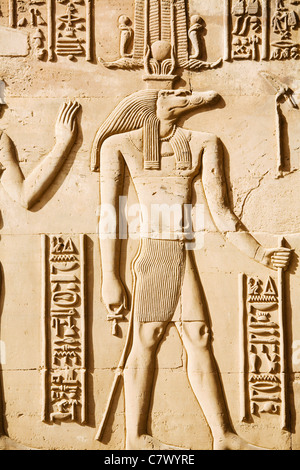 Relief wall-carving of the crocodile headed god Sobek at the Ptolemaic ruins of Kom Ombo on the Nile River in southern - Stock Photo