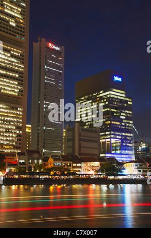 Boat Quay and Singapore River at dusk, Singapore - Stock Photo