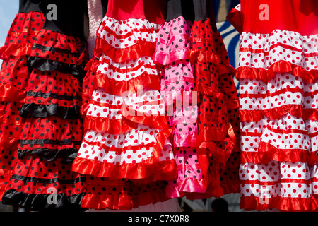 colorful red pink gipsy costumes of flamenco dancer in andalusian - Stock Photo