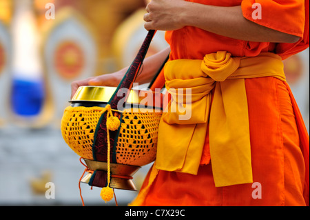 Buddhist monks walking with monk bowl to collect food in the morning. UNESCO listed world heritage city of Luang - Stock Photo
