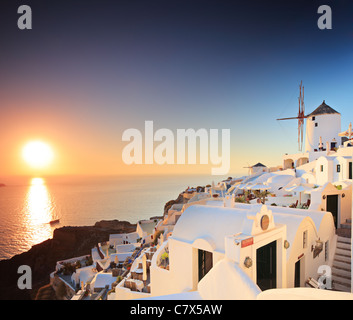 A view of a village on Santorini island and a sunset - Stock Photo