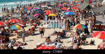 Summer vacation. holiday maker on a crowded beach. Photographed at Nitsanim Beach, Israel
