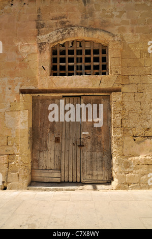 Grunge No Admittance sign on old wooden door locked with padlock in Mdina, Malta - Stock Photo