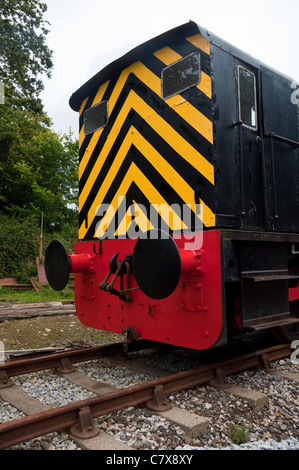 Train buffers and brightly coloured warnings painted on the rear / end elevation of a train engine.  UK. - Stock Photo