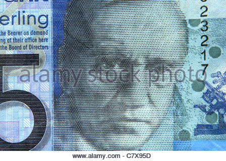 Scottish banknotes.Image of Sir Alexander Fleming on a Clydesdale Bank five pound note - Stock Photo