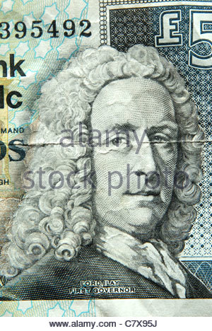 Scottish banknotes. Image of Archibald Campbell, 3rd Duke of Argyll, 1st Earl of Ilay on a RBS five pound note - Stock Photo