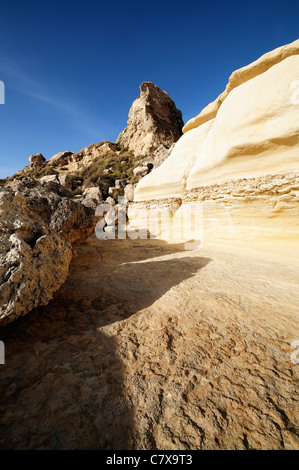 Rock formations and blue sky along Malta coastline - Stock Photo