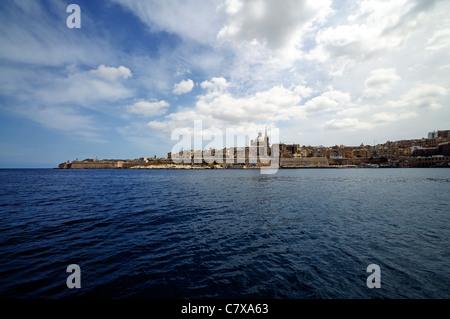 A view of the Valletta skyline over Marsamxett Harbour from Sliema, Malta. - Stock Photo