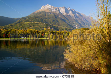 Dent d'Arclusaz and fall colors reflecting in Carouge lake near Saint Pierre d'Albigny in the Bauges mountain range - Stock Photo