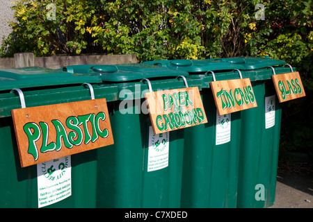Plastic, Paper & Cardboard, Tin Cans, Glass, Labelled Green Plastic Flip-Top Refuse Litter Bins for Recycling bottles, - Stock Photo