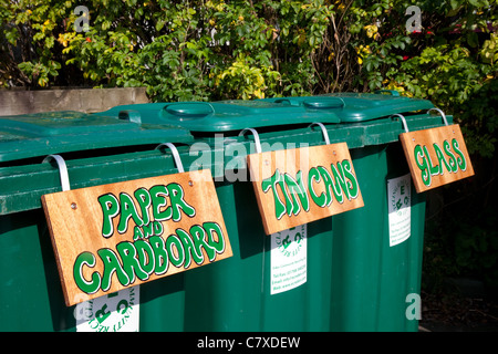'Paper and Cardboard', Tin Cans, Bottle bins, Glass_Labelled Green Plastic Flip-Top Wheelie Refuse Bins for Recycling - Stock Photo