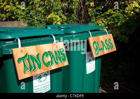 'Tin Cans ' Glass. Labelled Green Plastic Flip-Top Refuse Bins, bin, trash, garbage, recycle, waste, recycling, - Stock Photo