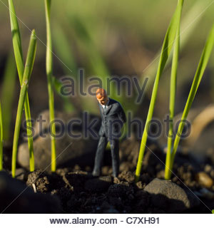 Solitary young male figure walking alone looking down - Stock Photo