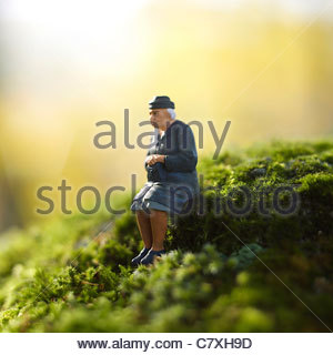 Solitary elderly female figure alone - Stock Photo