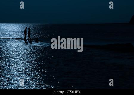 A couple on the beach at Kimmeridge Bay, Dorset, UK - Stock Photo