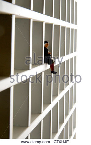 Small toy figures on a shelf - Stock Photo