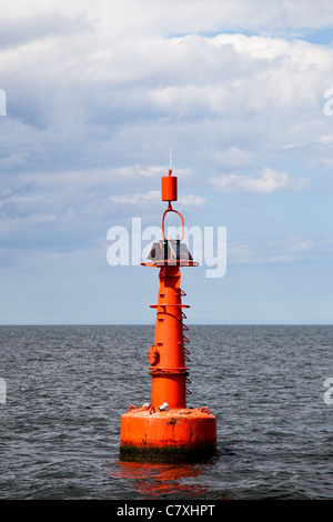 The red buoy in the Baltic Sea. - Stock Photo