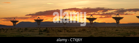 The Very Large Array, which is a large array of satellite dishes that is used to probe deep space, is seen at sunset. - Stock Photo