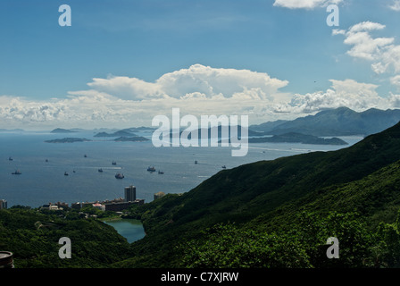 A view of Pok Fu Lam country park and Pok Fu Lam reservoir with the West Lamma Channel with Lantau island in the - Stock Photo