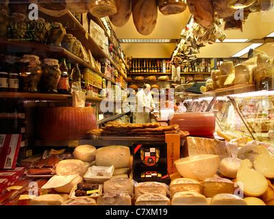 Delicatessen food store with cheese, ham, wine, in the Via dei Condotti shopping district in Rome, Lazio, Italy - Stock Photo