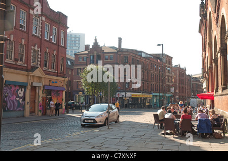 Street scene in the Norther Quarter district of city centre Manchester. - Stock Photo