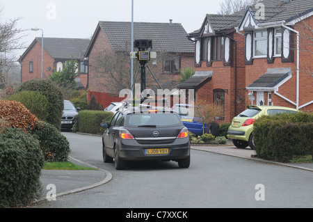 A Google car drives down a residential cul de sac in Manchester. Photographing and mapping the street for google - Stock Photo