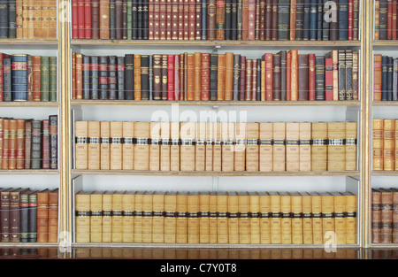 Old books on shelves at the library in Wrest Park. Silsoe, Bedfordshire, UK