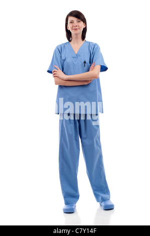Full length of a young nuse, medical doctor wearing blue scrubs standing isolated over white background - Stock Photo