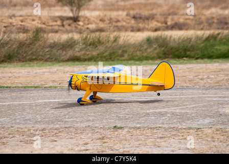 Radio control, yellow airplane in land - Stock Photo