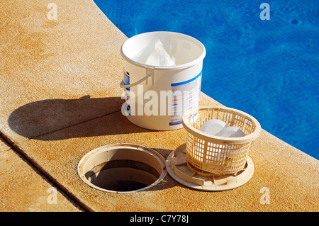 Pool chlorine tablets in basket and tub at poolside, Calahonda, Mijas Costa, Costa del Sol, Andalucia, Spain, Western - Stock Photo