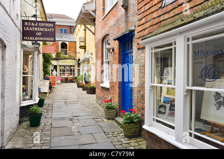 Shops and cafe on a side street off the High Street in the market town of Marlborough, Wiltshire, England, UK - Stock Photo