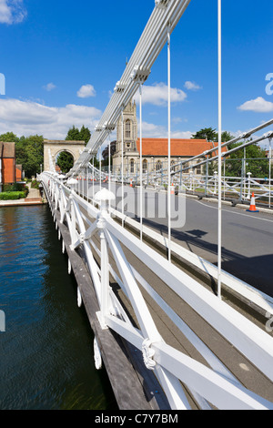 19th Century suspension bridge over the River Thames in Marlow with All Saints Church behind, Buckinghamshire, England, - Stock Photo