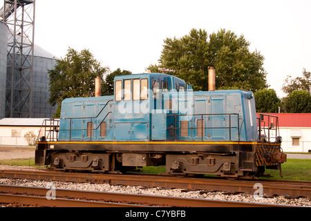 Train head car stopped on tracks near town - Stock Photo