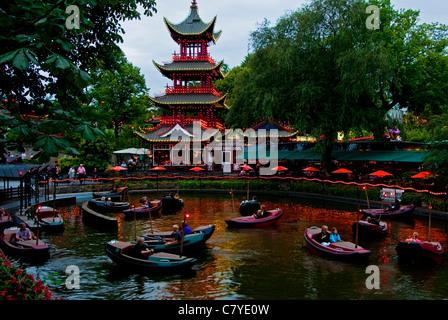 Dragon Boat Lake in Tivoli Gardens amusement park in Copenhagen - Stock Photo