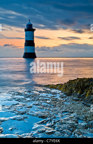 Dawn at Penmon Point Lighthouse, Penmon, Isle of Anglesey, North Wales, UK - Stock Photo