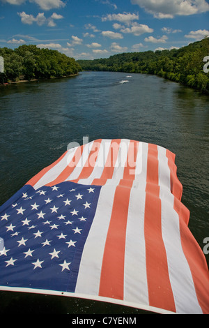 Large American flag hanging from a walking bridge over the Delaware River in Bucks County, Pennsylvania - Stock Photo