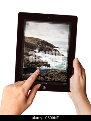 Hands holding an iPad2 using a Photoshop app to edit a photo - Stock Photo